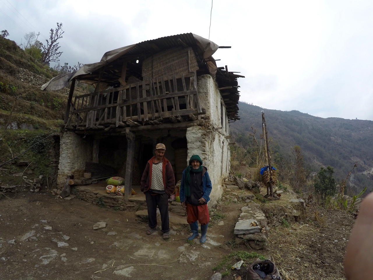 Mir & son near damaged home.