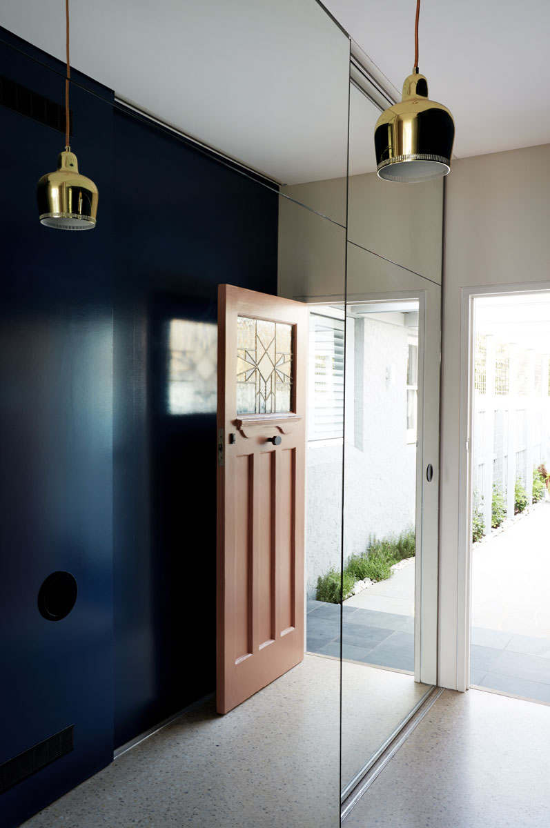 Punches of navy blue were introduced throughout to inject personality and a sense of continuity between the original part of the house and the new extension.