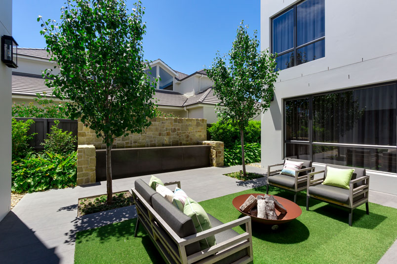 """""""The central courtyard is a lounge space which is an extension of the kitchen — the kitchen's actually opposite with big sliding doors that open onto the central courtyard."""""""