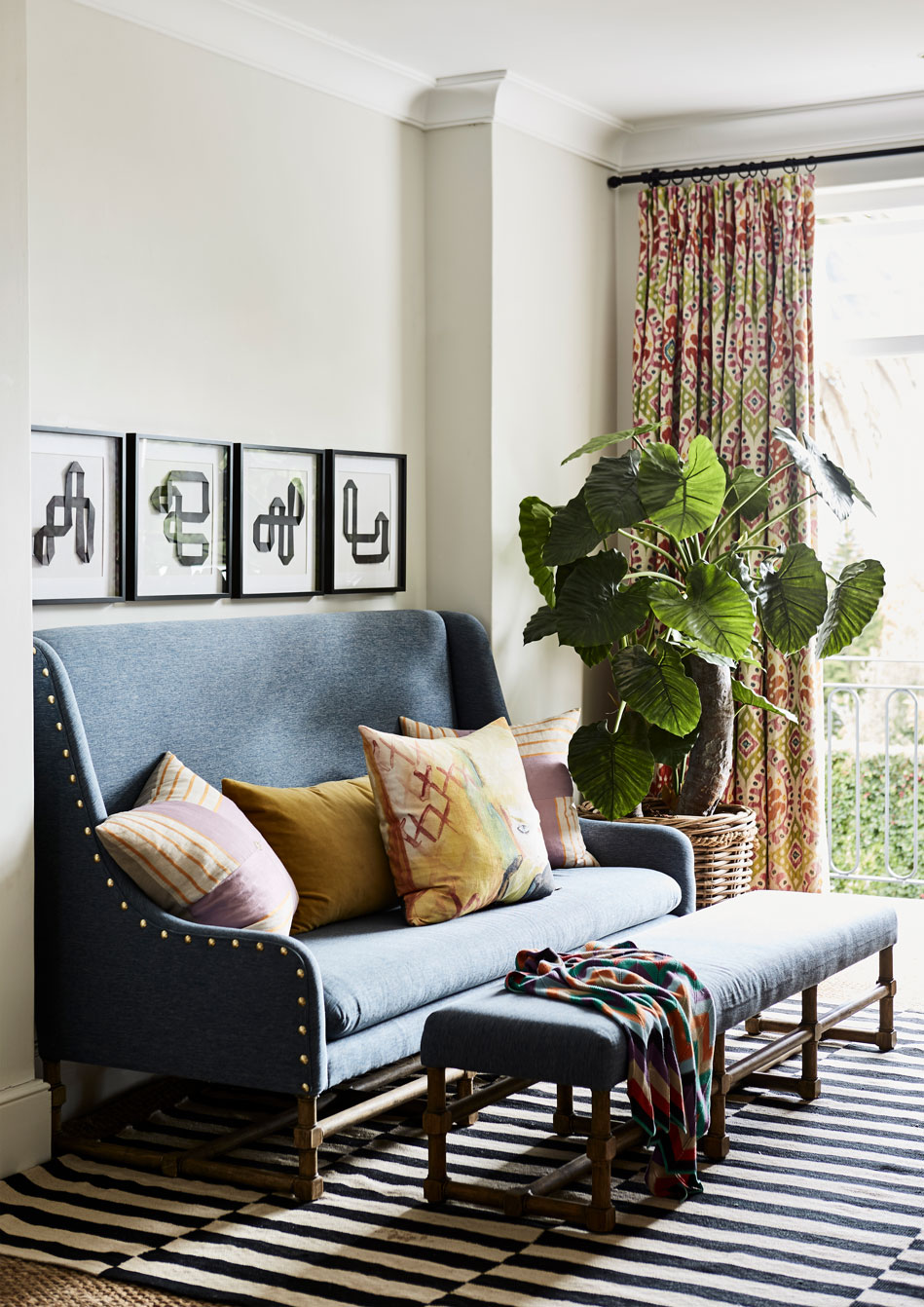 The casual 'pyjama' lounge area at the top of the stairs is furnished with a sky-blue couch and bench from La Grange Interiors. 