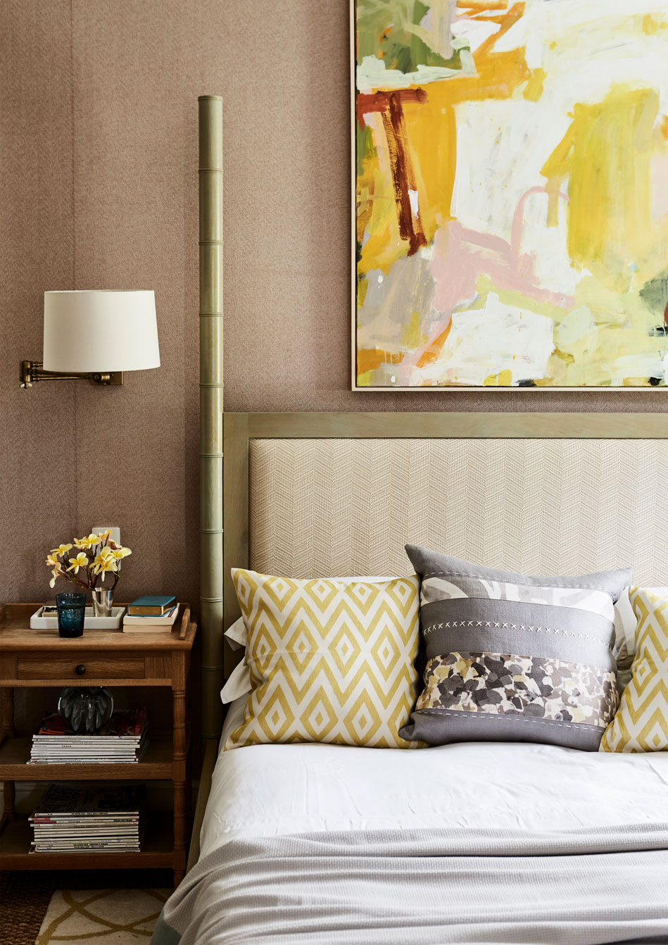 The main bedroom has a relatively muted colour palette, with the bright tones of the recently acquired artwork adding a few more vibrant tones.