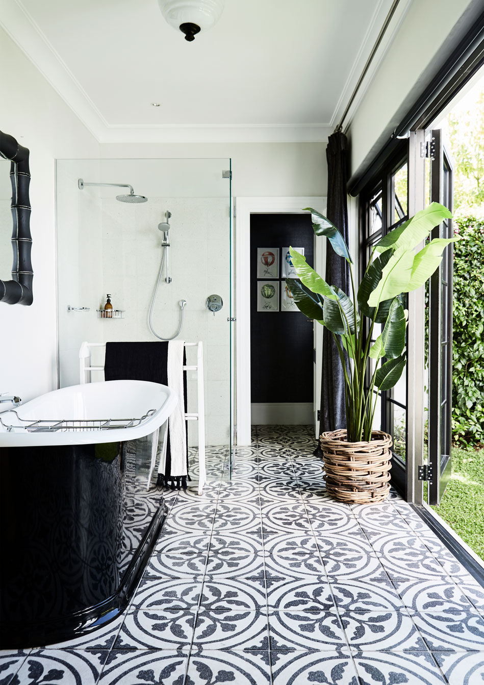 In the guest suite, the bathroom leads out onto a private courtyard.