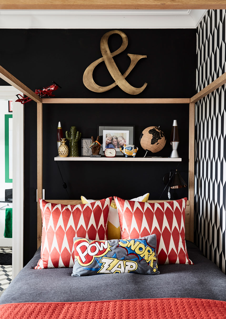 In Kim's son Jamie's room, the decor is bold and graphic with lots of black and white, punctuated by bright red accents including these scatter cushions.