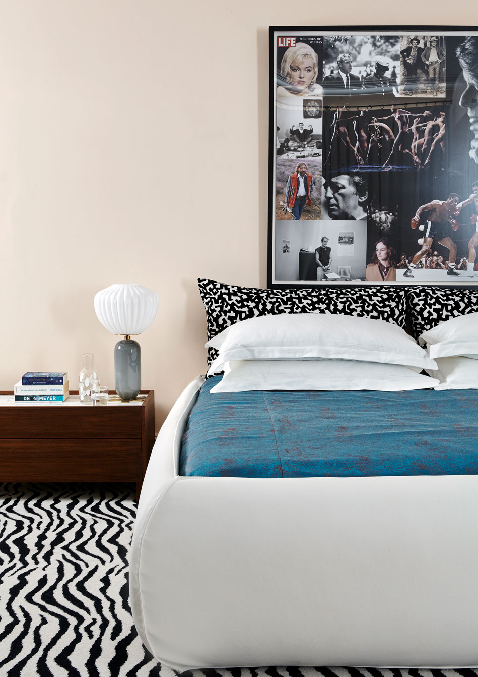 The bed was bought at Italian brand Baxter and the Life picture in New York. The 'don Giovanni' lamp is by India Mahdavi and the iridescent dragon fabric silk bed cover by Jean Paul Gaultier.
