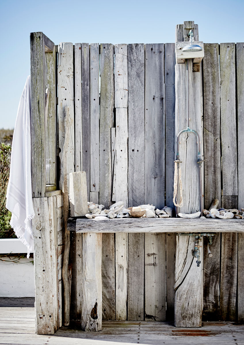 The outdoor shower constructed from sleeper wood with copper fitting is just the place to rinse the sea out of your hair and the sand off your feet after the perfect surf session.
