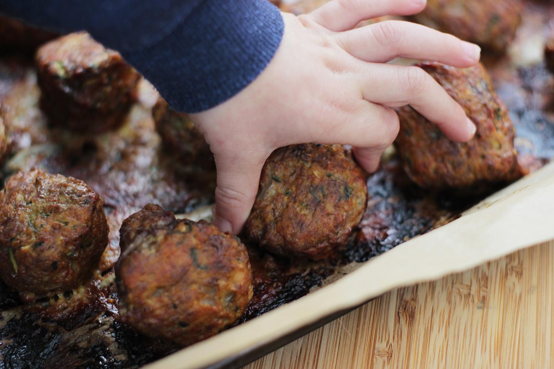 hand grabbing meatball.jpg