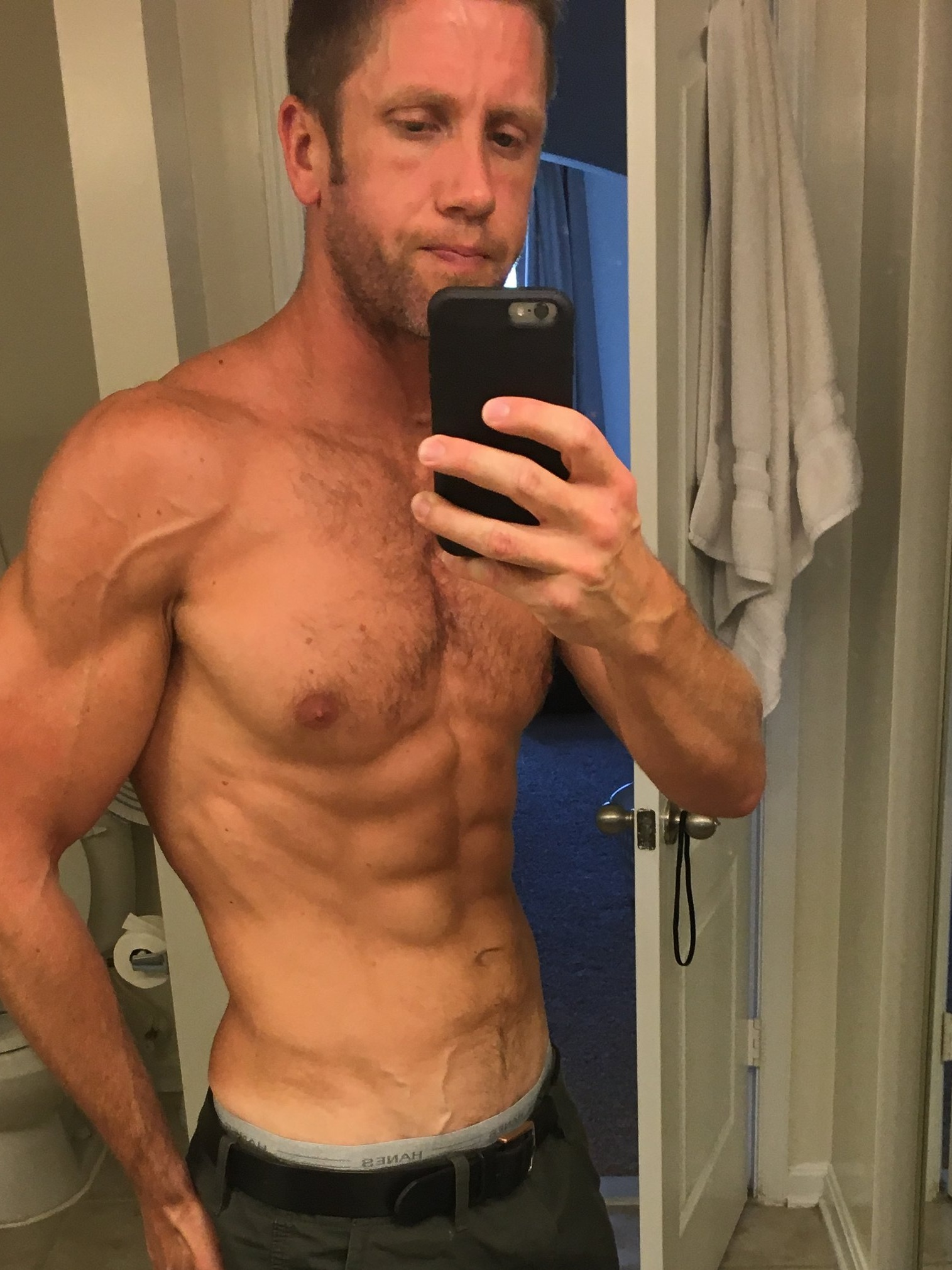 *Bathroom selfie alert (this was hard for me to post as selfie's aren't my style. It made sense in the context of this post, so against my better judgement here it is)   * This was me flexing in the mirror a couple years ago after blitzing my abs with a similar protocol for 8 weeks. While great for the 6-pack, this program does nothing to cure a man's inability to put the toilet seat down after use.