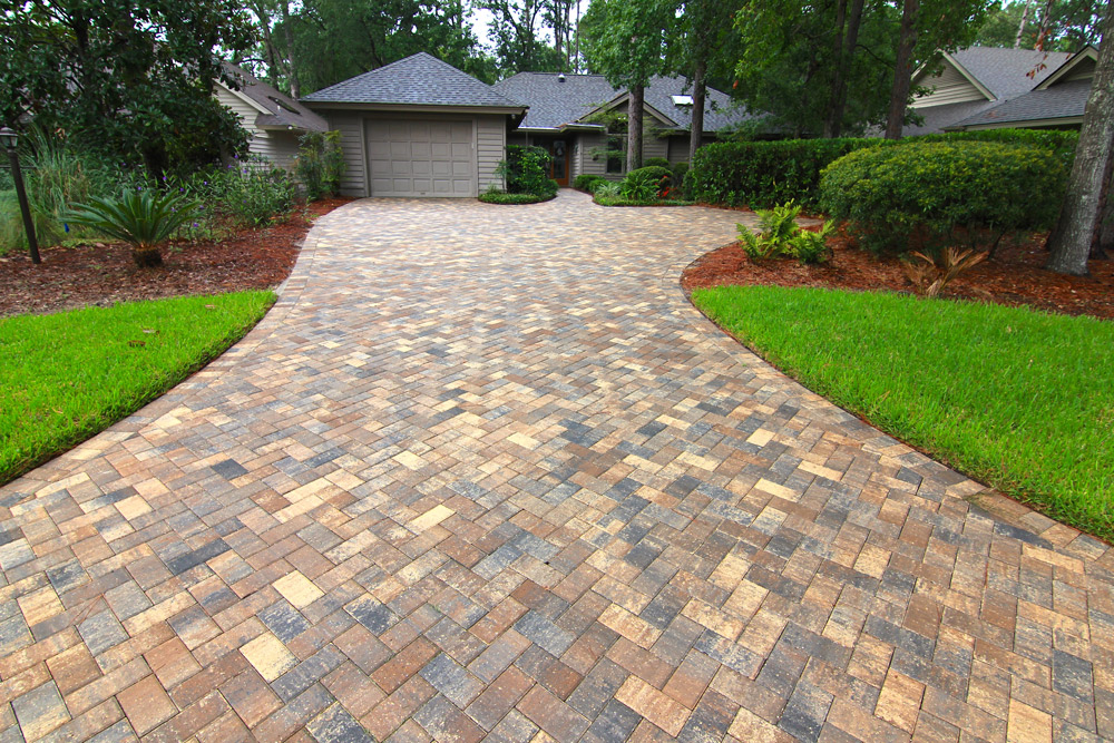 "Herringbone Pattern  - Pavers are laid in a ""V"" shape pattern. This pattern can be laid at 45 or 90 degrees. The Herringbone pattern not only adds character to your driveway, but it is also known for its strength and durability. It is recommended in high traffic areas."