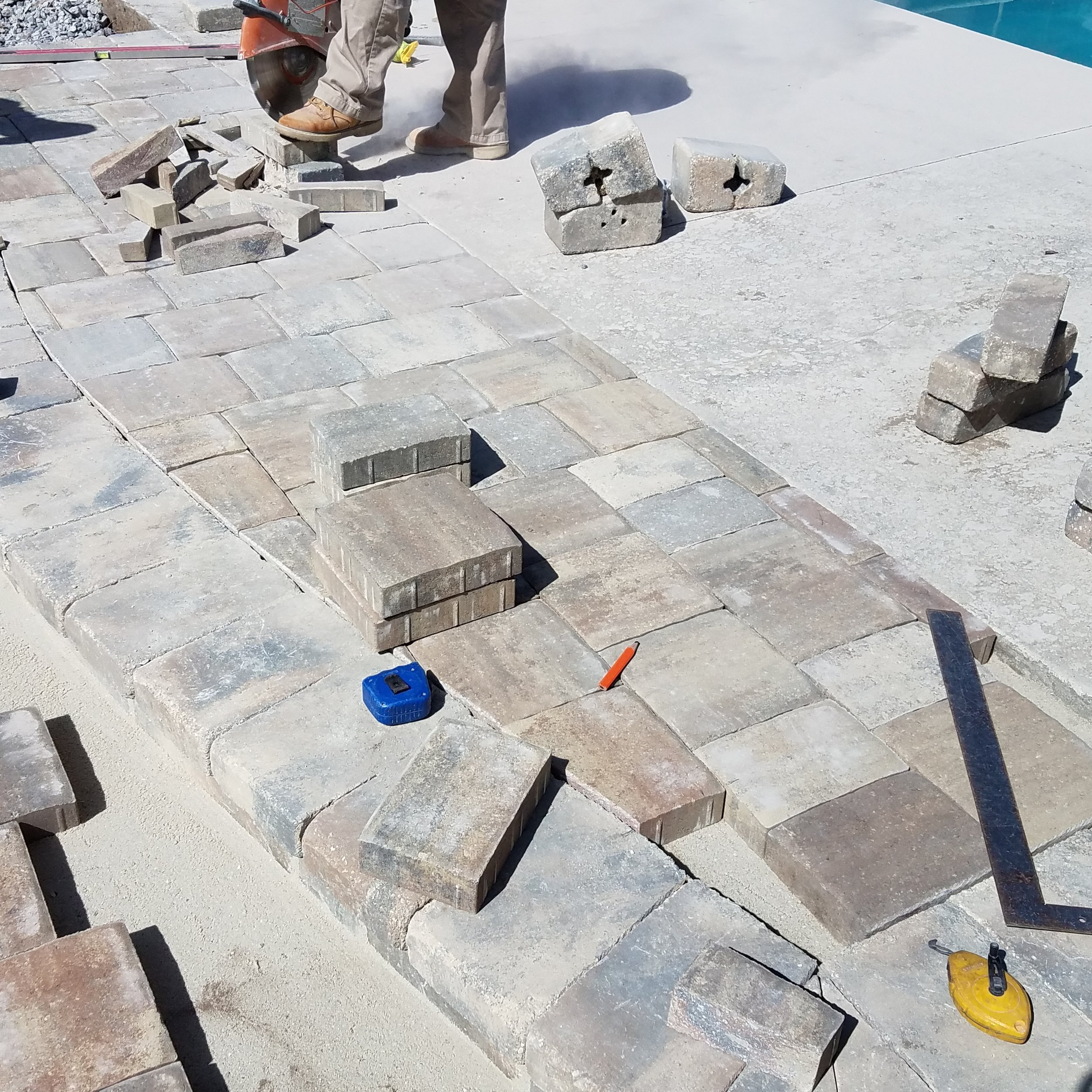 installation of paver pool deck