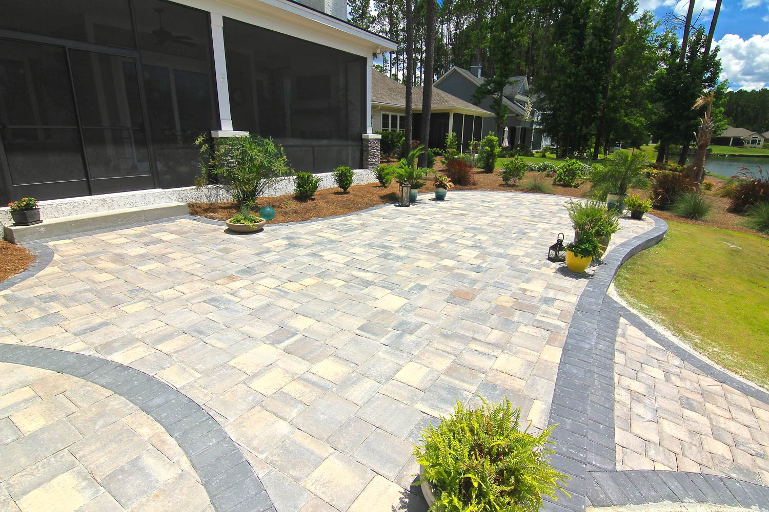 AFTER: The new patio area offers plenty of space to entertain and eliminates the sloped portion of the yard.