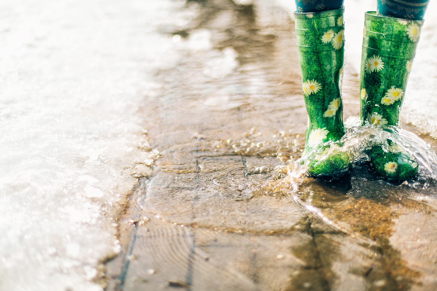 Puddles may be fun for the kids, but they are a sign of poor driveway drainage!