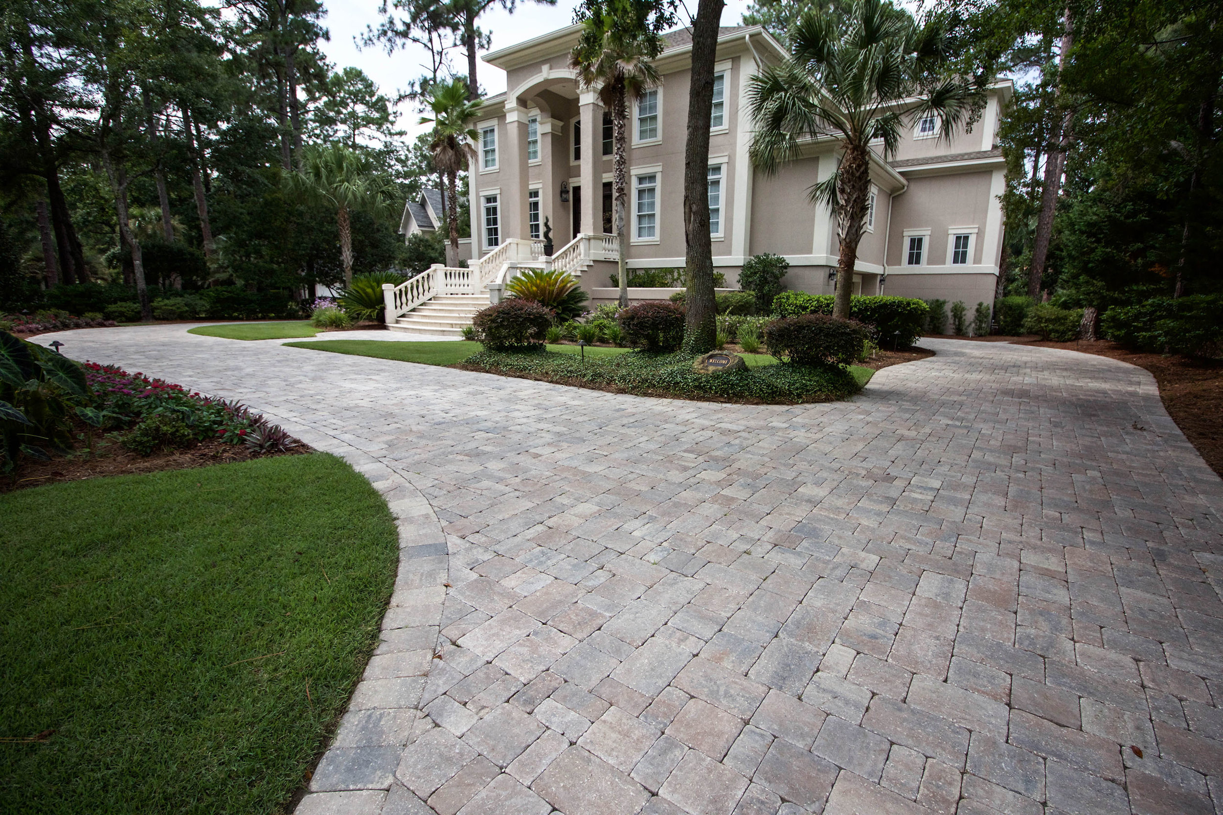 A driveway with a properly installed base will be beautiful and strong for years to come.