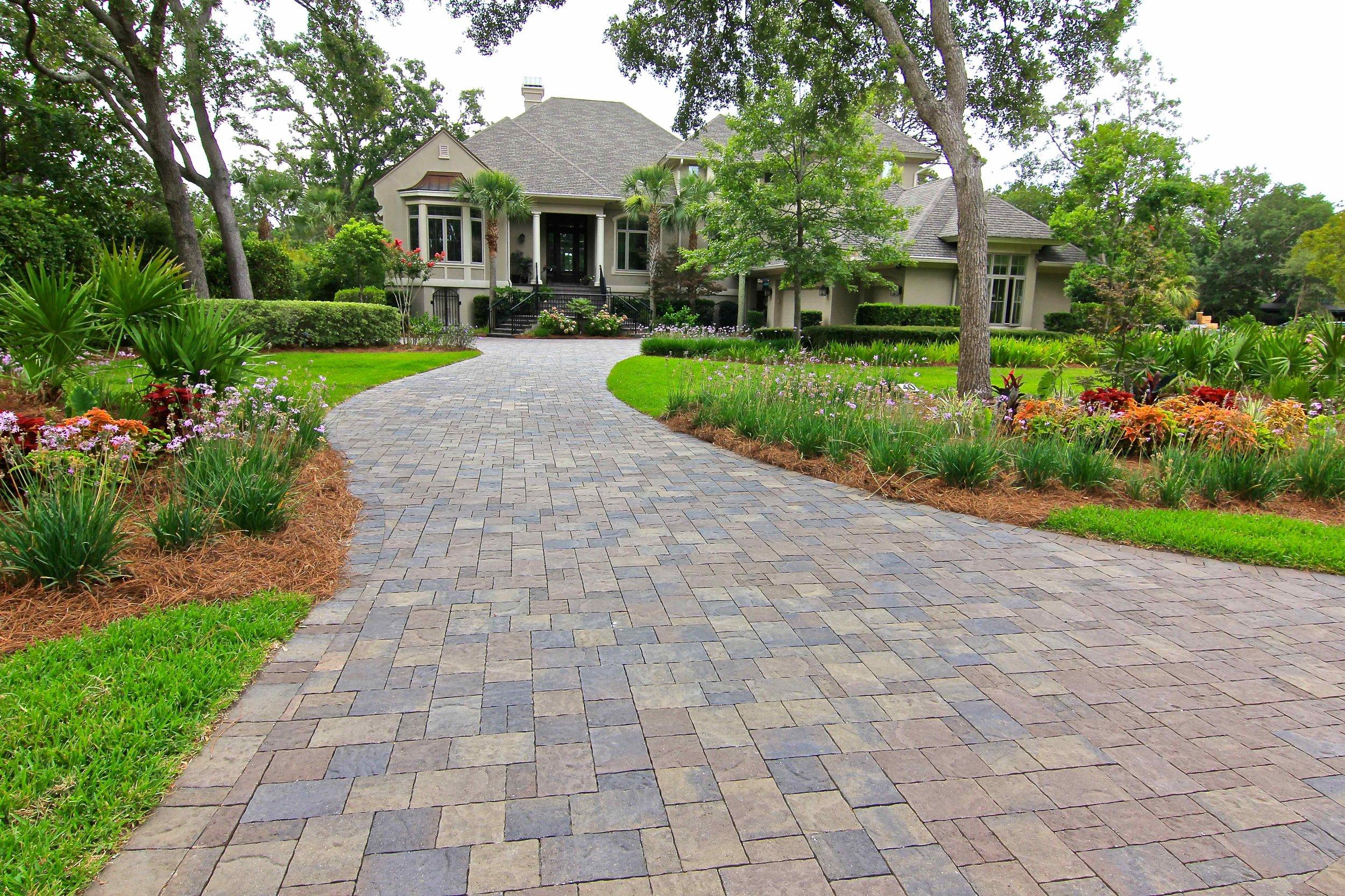 This driveway has a more subtle paver edge.
