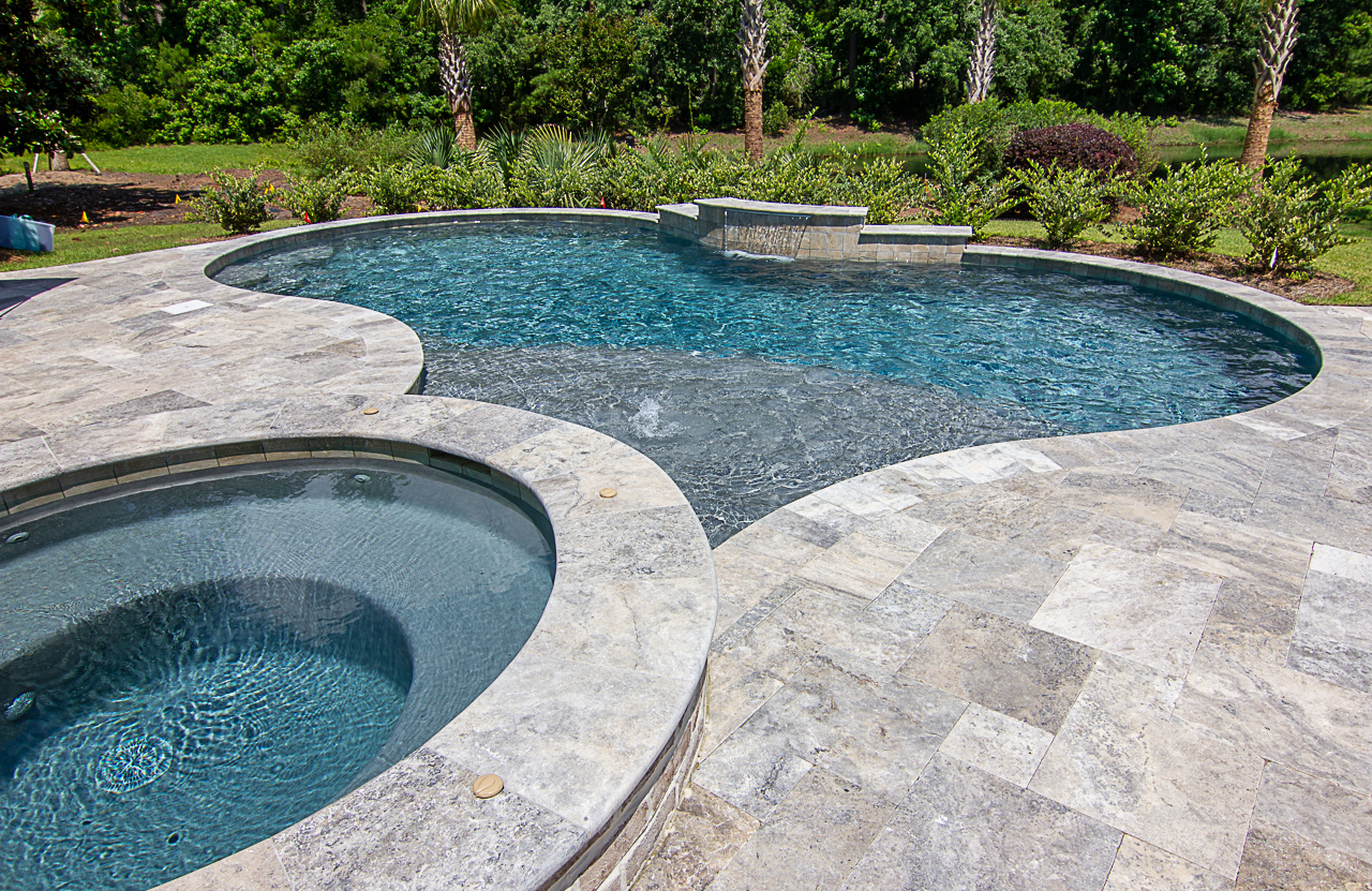 Elegance is just one of the reasons why our clients choose to install  Travertine  on their pool decks!