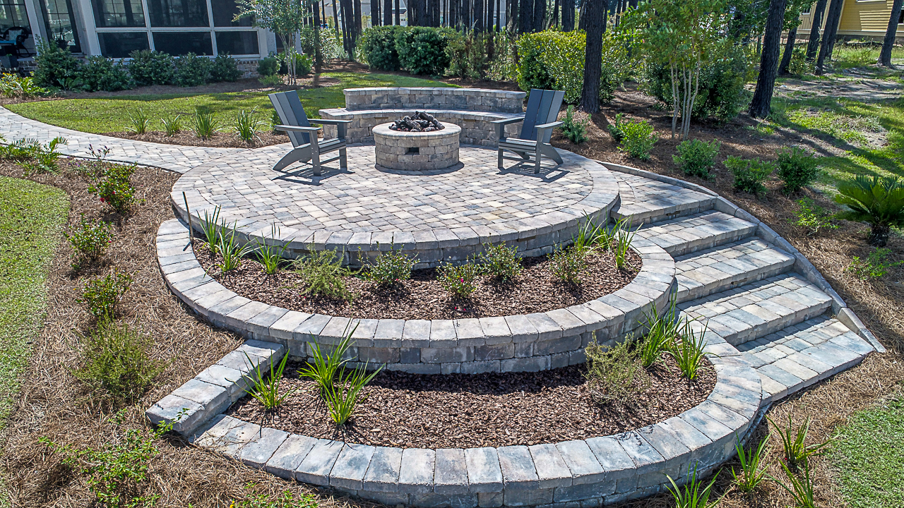 Installed in  Bluffton, SC  - this  Tremron, Sierra  colored,  Paver Patio , boasts: a  gas burning fire pit  and a  dual tier paver seating wall.  Relax, Sit Back and Enjoy!