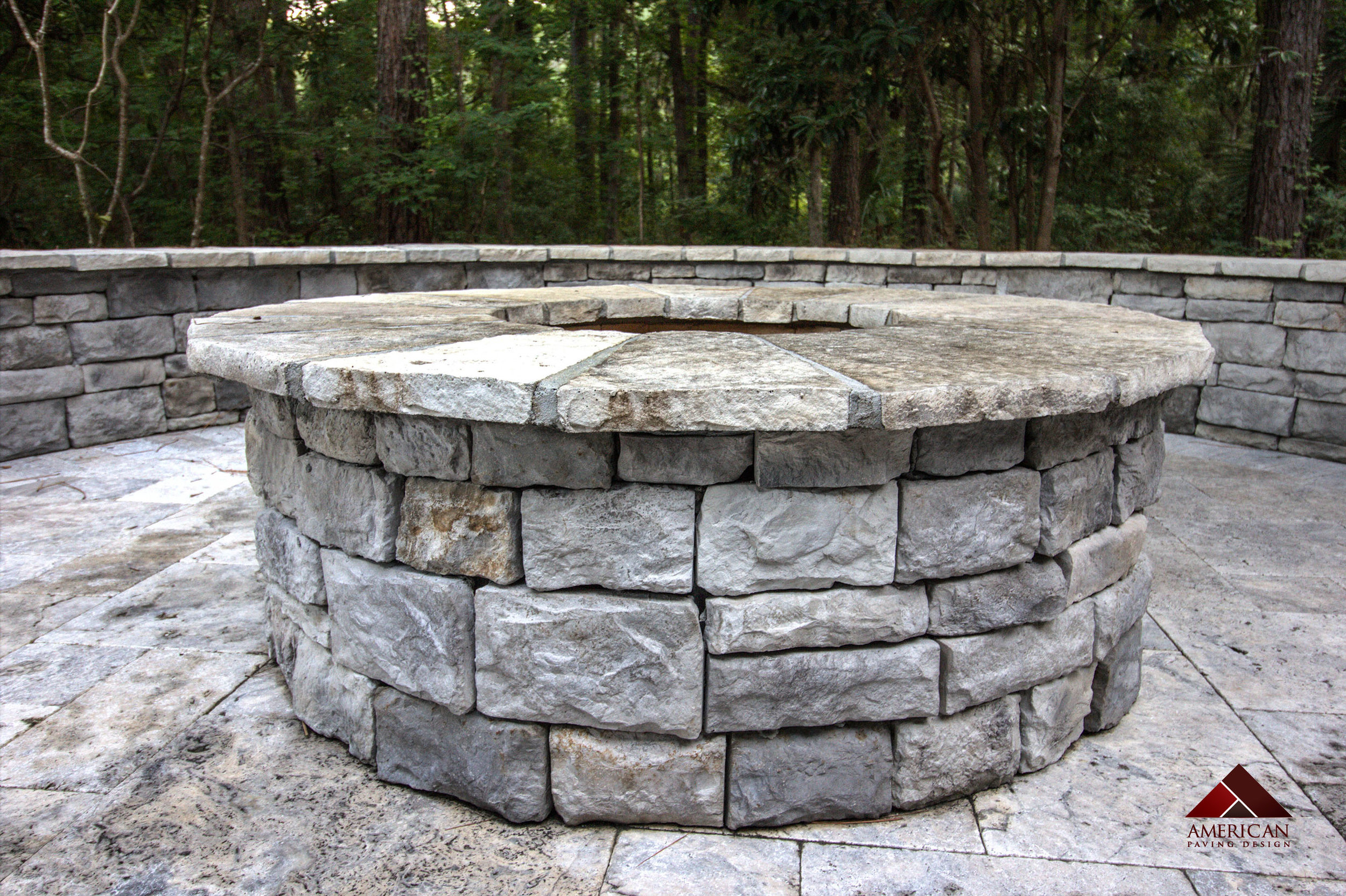 This Outdoor Fire Pit was built using Silver Travertine. Do you love the smell and warmth of crisp burning fire wood? Then consider adding a wood-burning fire pit to your paver patio!