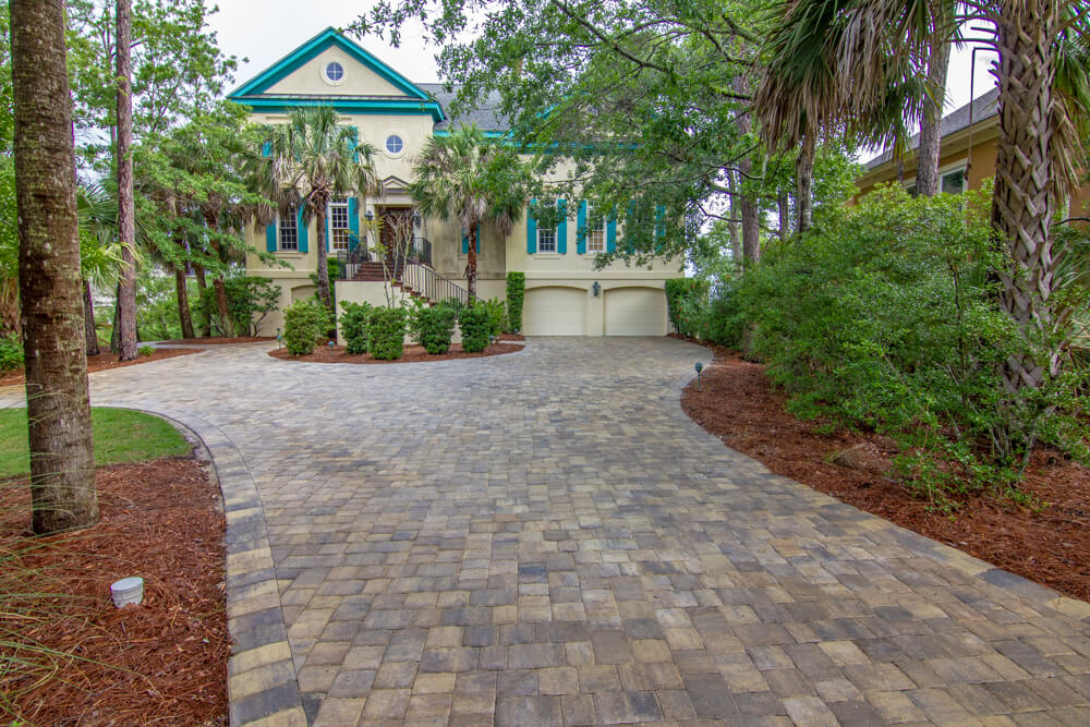 Installed in Hilton Head Island, SC - this unique,  Brick Paver Driveway  is stunning. Using Tremron's 3pc, Sierra paver, this client can now enjoy a driveway just as beautiful as their home. WELCOME HOME!  Need  a Paver Driveway  at your home?  Contact, American Paving Design!
