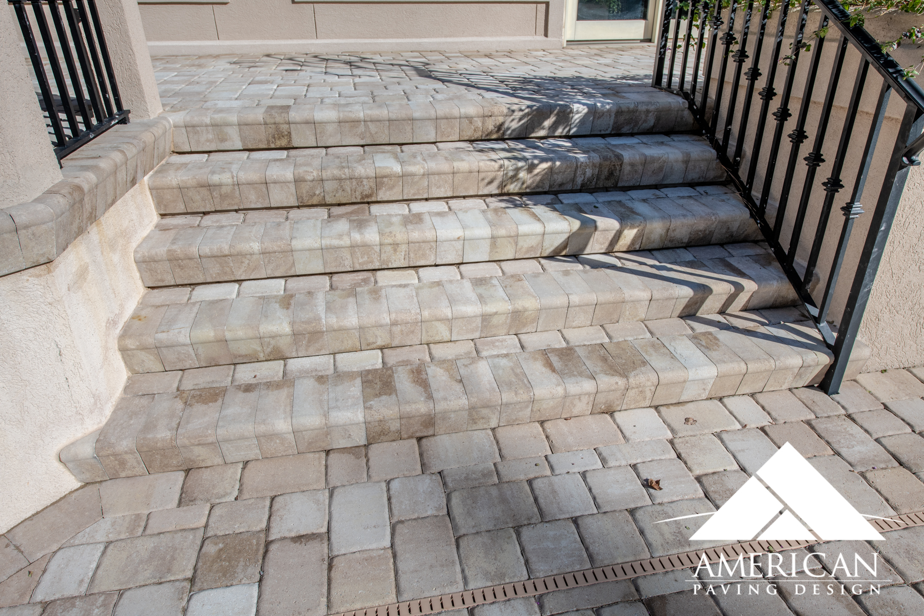 Installing Brick Paver Steps Around Your Outside Porch Makes Transitioning From The Patio To the Pool Deck Much Easier!