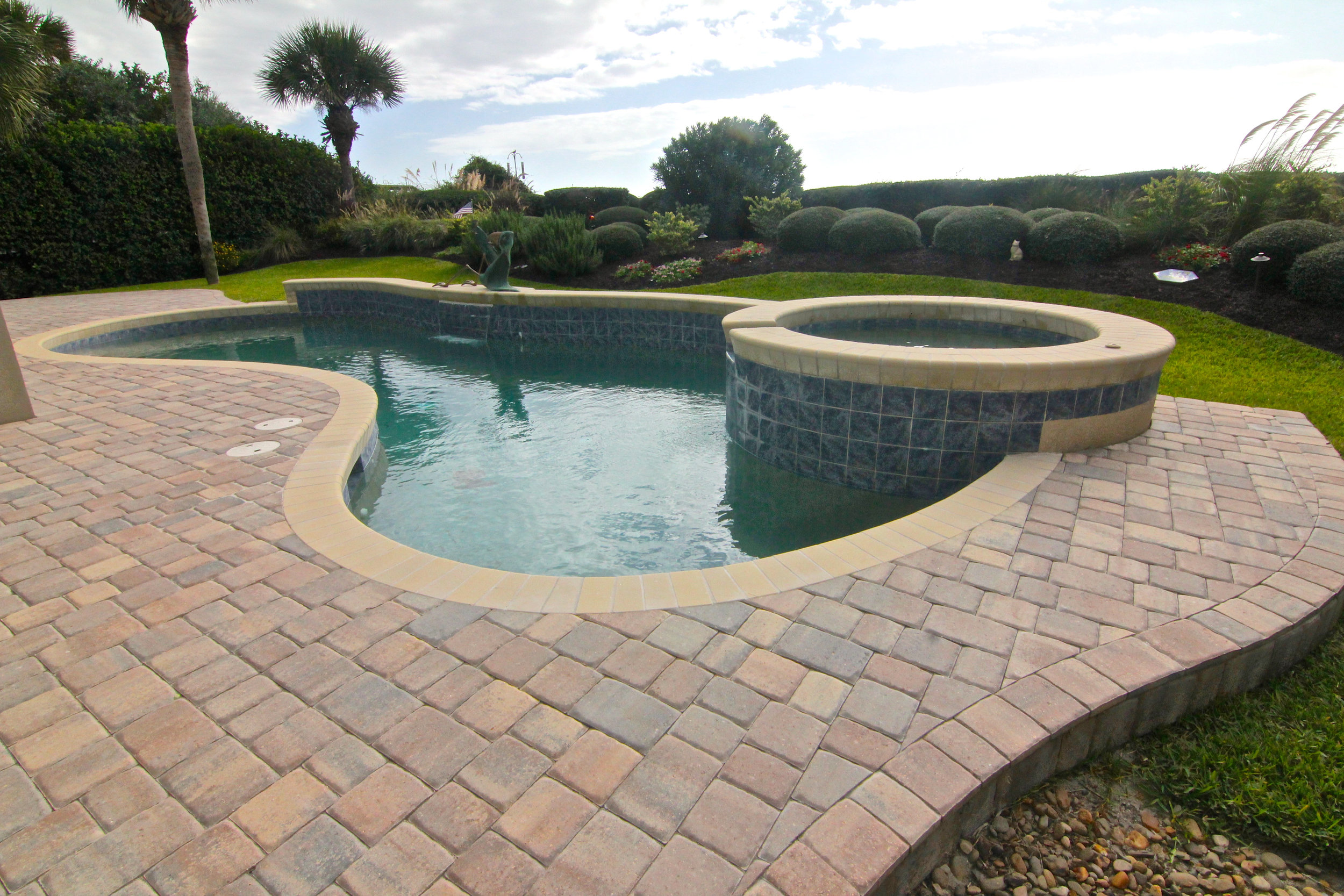 Using A Thin Paver To Overlay Your Pool Deck Is A Great Idea.  Choosing To Remodel Your Pool Deck - Gives You Plenty of Options When It Comes to Selecting The Ideal Paver Color and Texture.