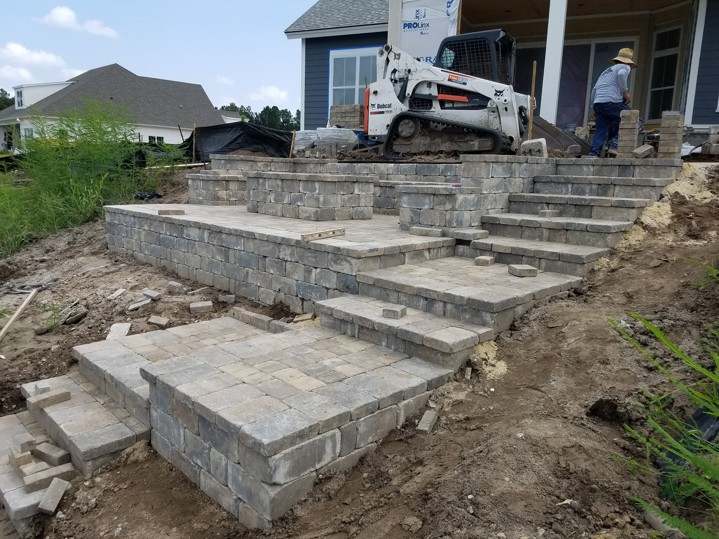 Retaining Wall Installation With Paver Steps