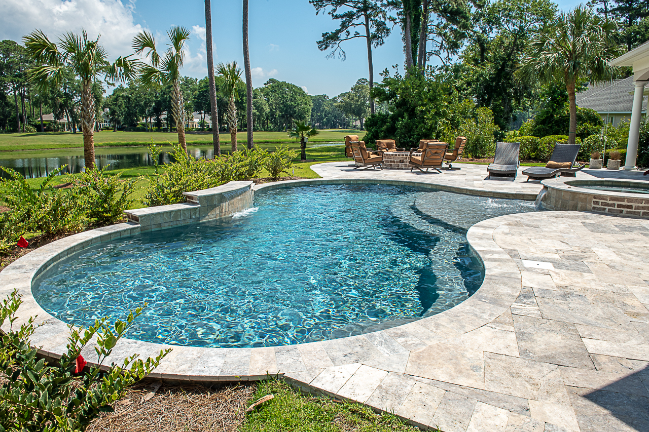 Silver Travertine Pool Deck Remodel and Installation - HHI, SC