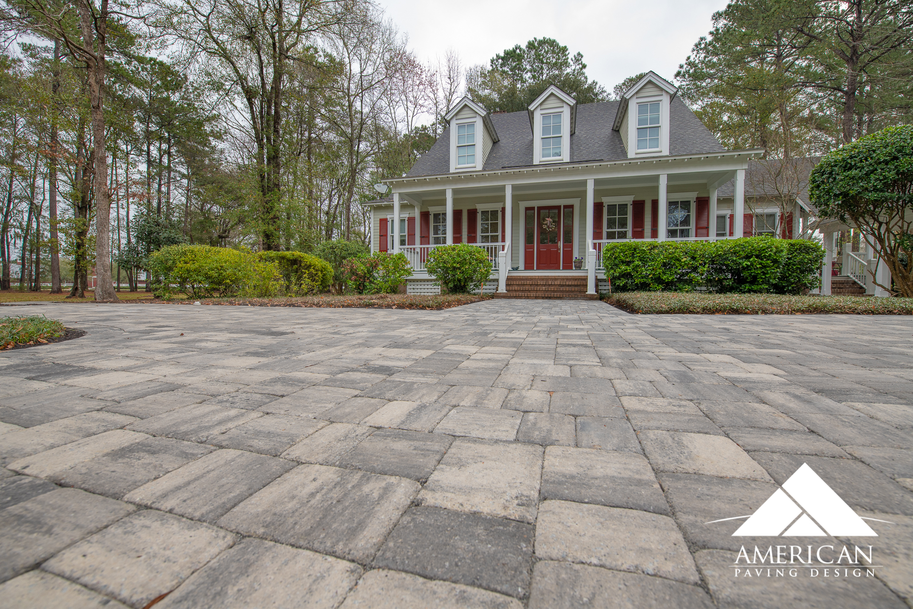 This large paver driveway installation is the perfect way to transform your homes entry way. This client choose:  Tremron's, Mega Olde Towne  paver in Glacier, tumbled.