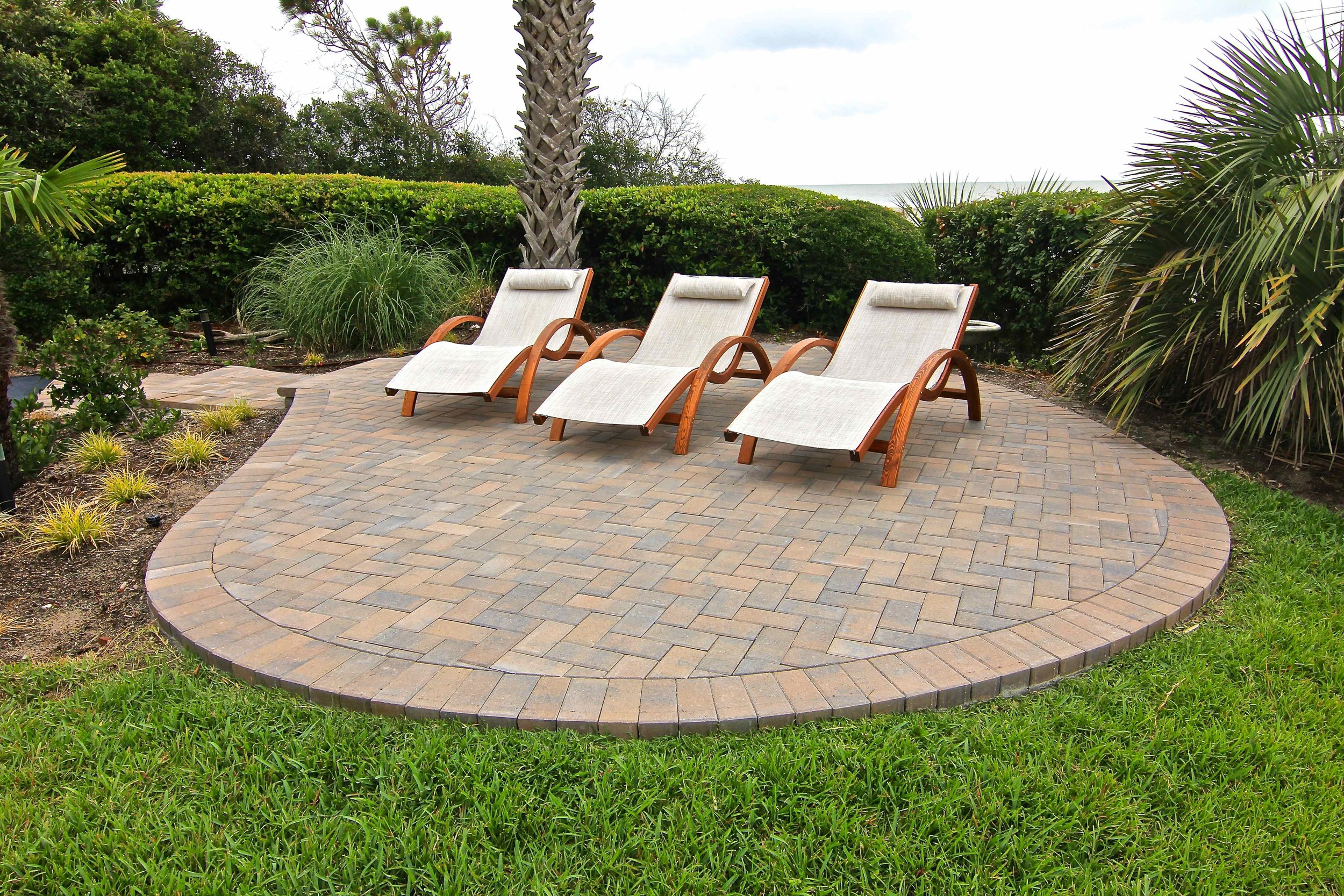 This small paver patio is great for any size backyard. With it's herringbone pattern and classic border you can't go wrong with a traditional  4x8 brick paver .