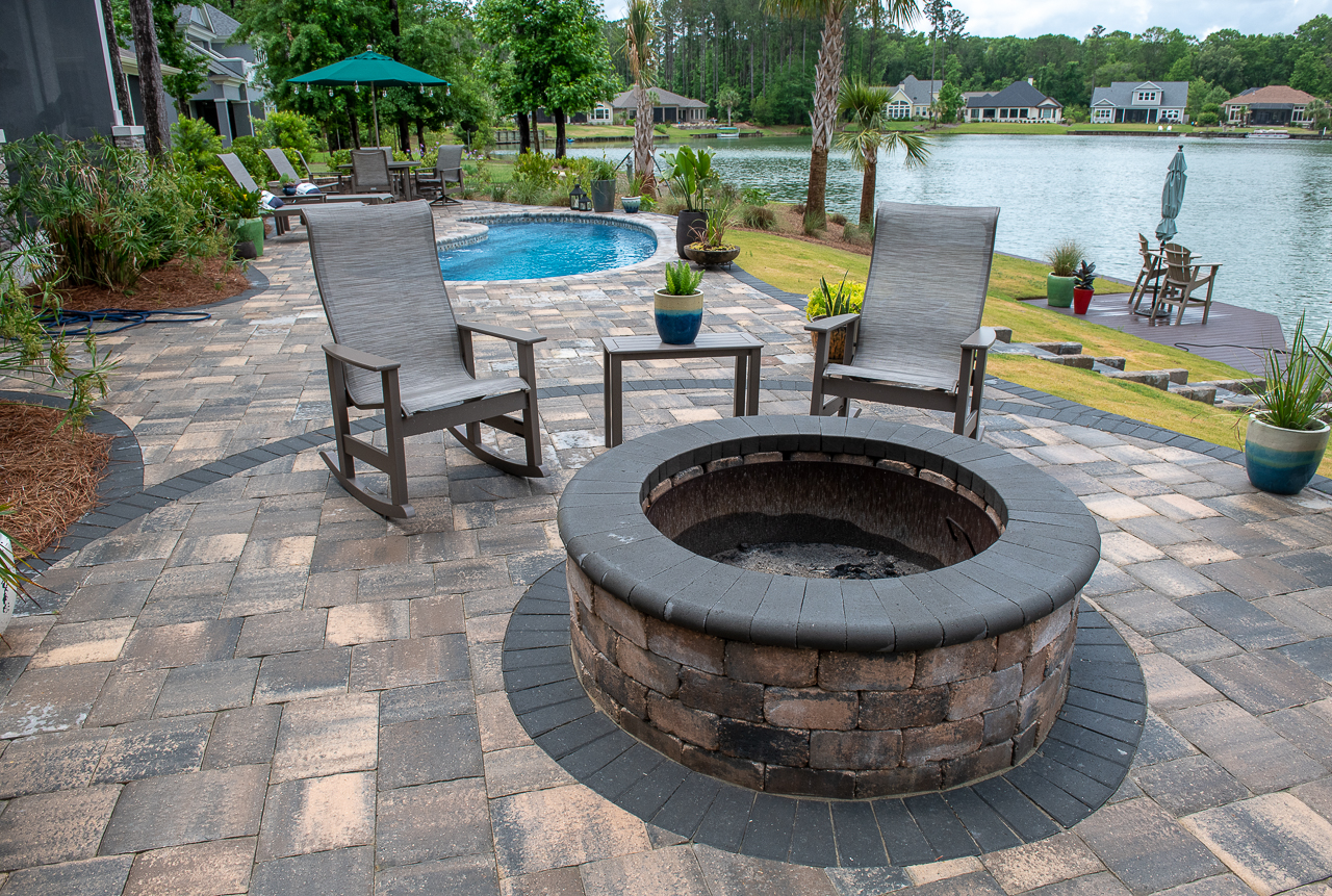 Love the scent of wood? We do too! This client designed his pool deck design with an outdoor fire pit and it's the perfect combination!