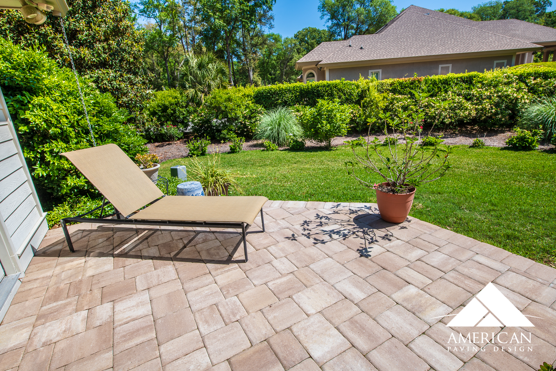 This small paver patio is great for any size backyard! With it's serene color scheme and perfect design, you can't go wrong with a traditional, brick paver patio!