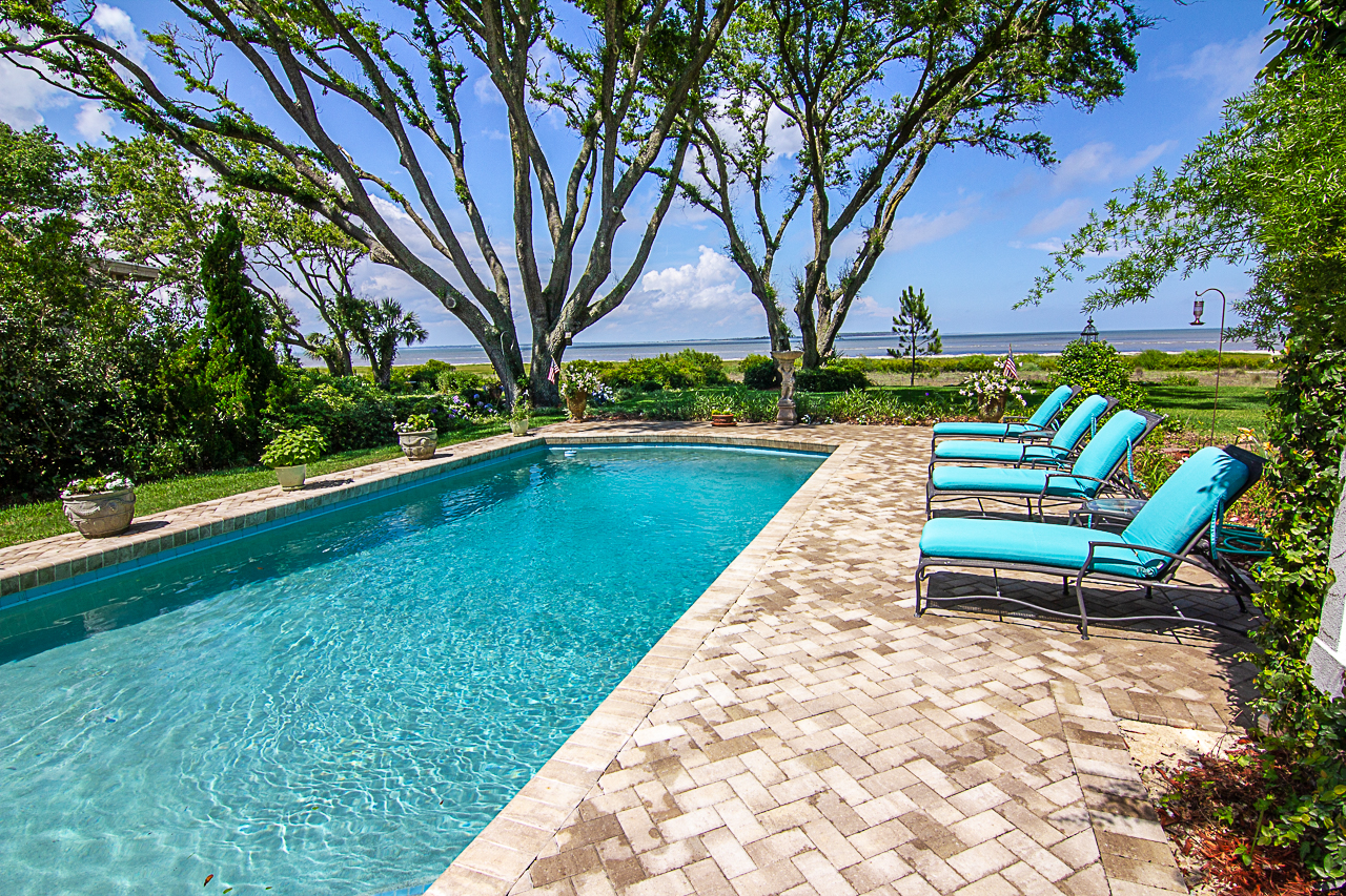This Tremron,  Olde Towne  sand dune pool deck is quite the retreat! Sit back, relax and take the stress off! Installing a new pool deck is the perfect way to enjoy those breezy, summer days!