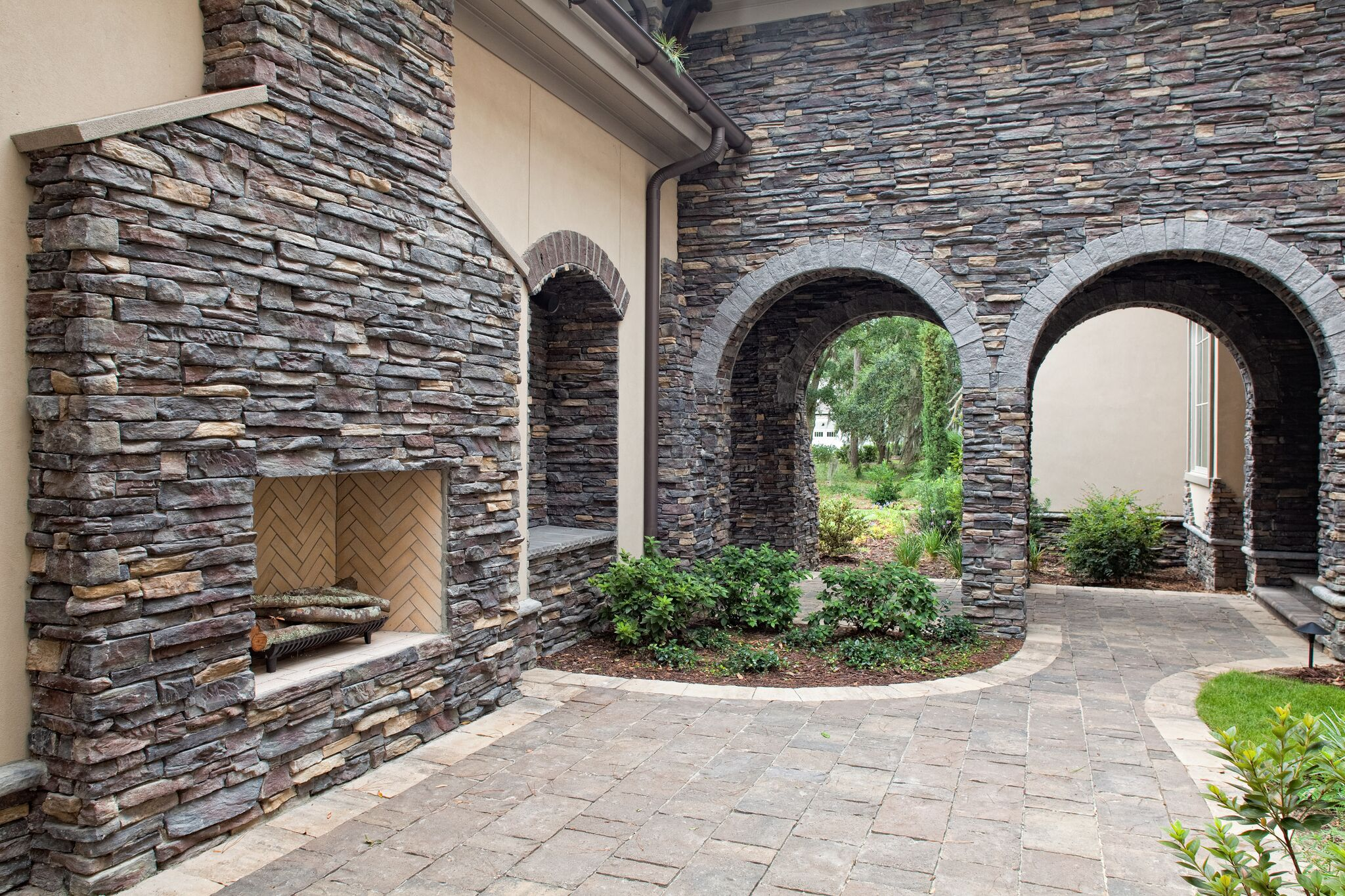 Facing your outdoor fireplace with stone is the perfect way to create a statement piece in your backyard. No matter your decor, there is always a stone ideal for your homes exterior!