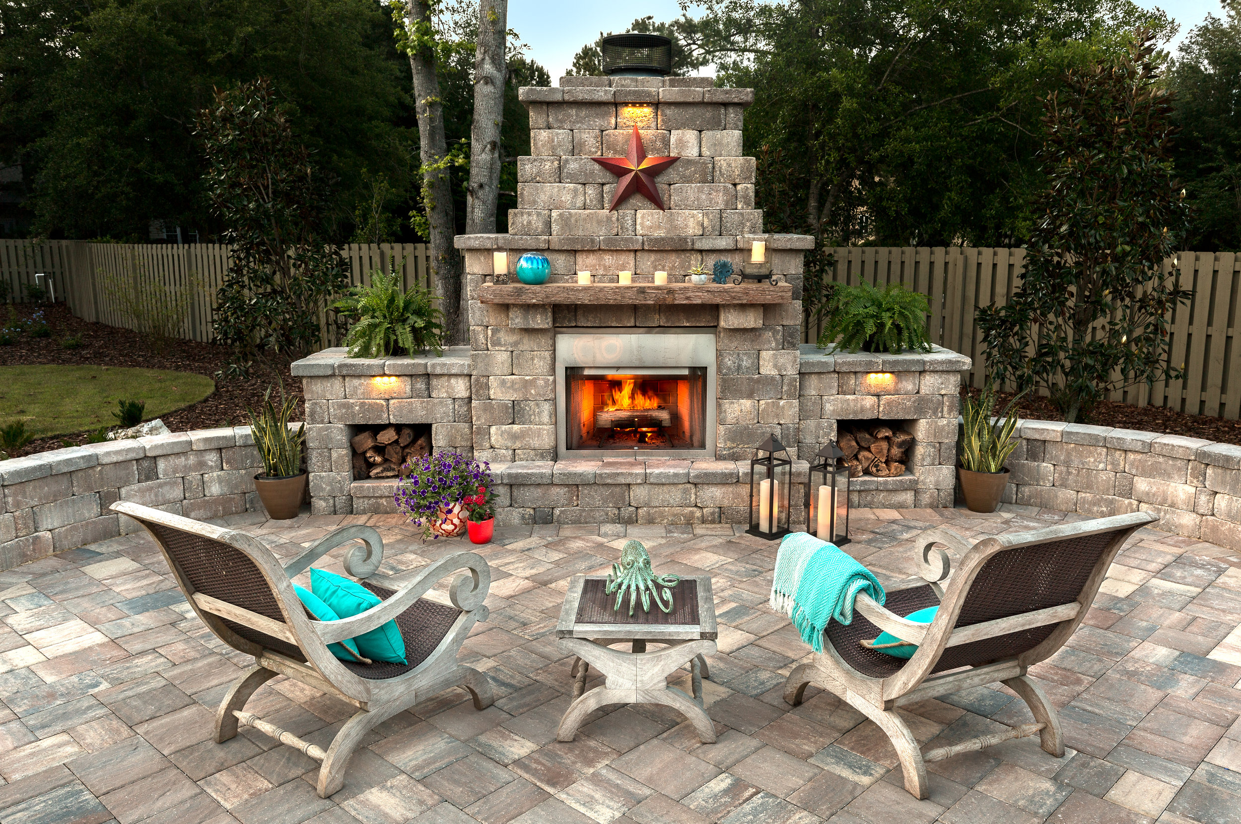 EXCEPTIONAL. This outdoor fireplace is pristine in every way! With its block-built structure, customized mantle and storage spaces, its the best place to sit back, relax and enjoy the cooler nights!