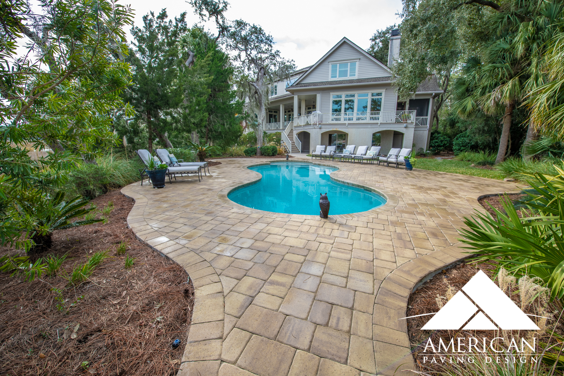 Relax On A Custom Paver Pool Deck