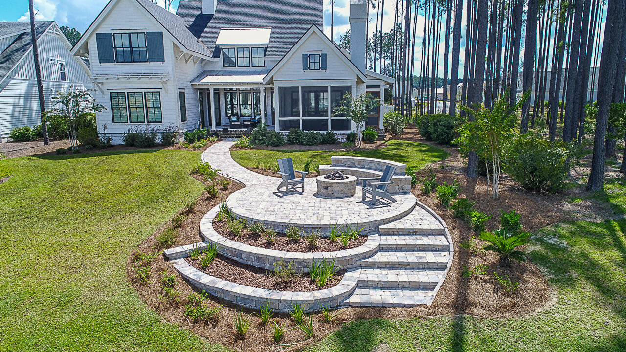 With the stability and durability of retaining wall block, constructing elevated patios like this one above are possible!