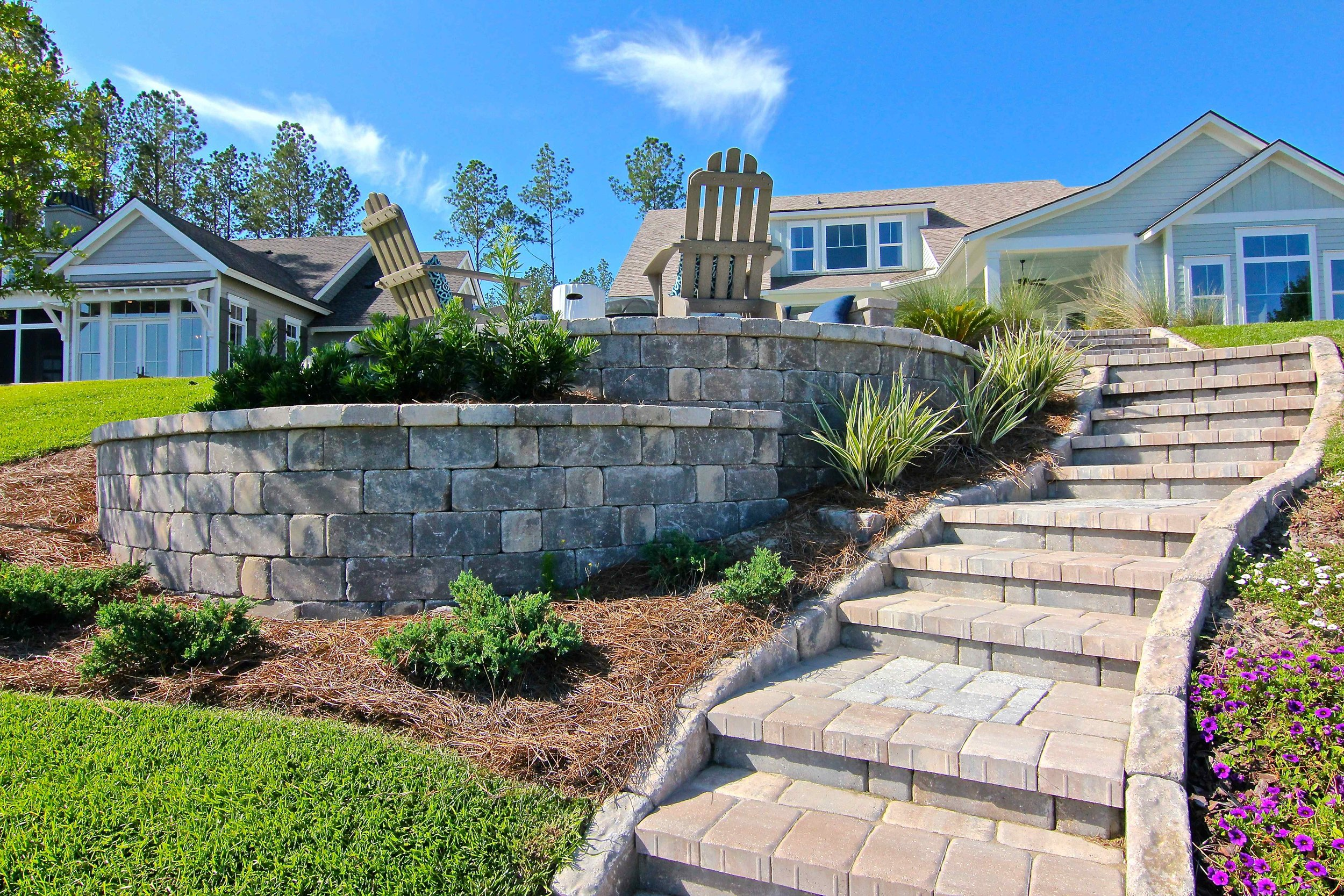 Small backyards can be the perfect place to design a paver patio. Pavers and wall block have the ability to be used vertically, allowing a small space to feel larger and more inviting.
