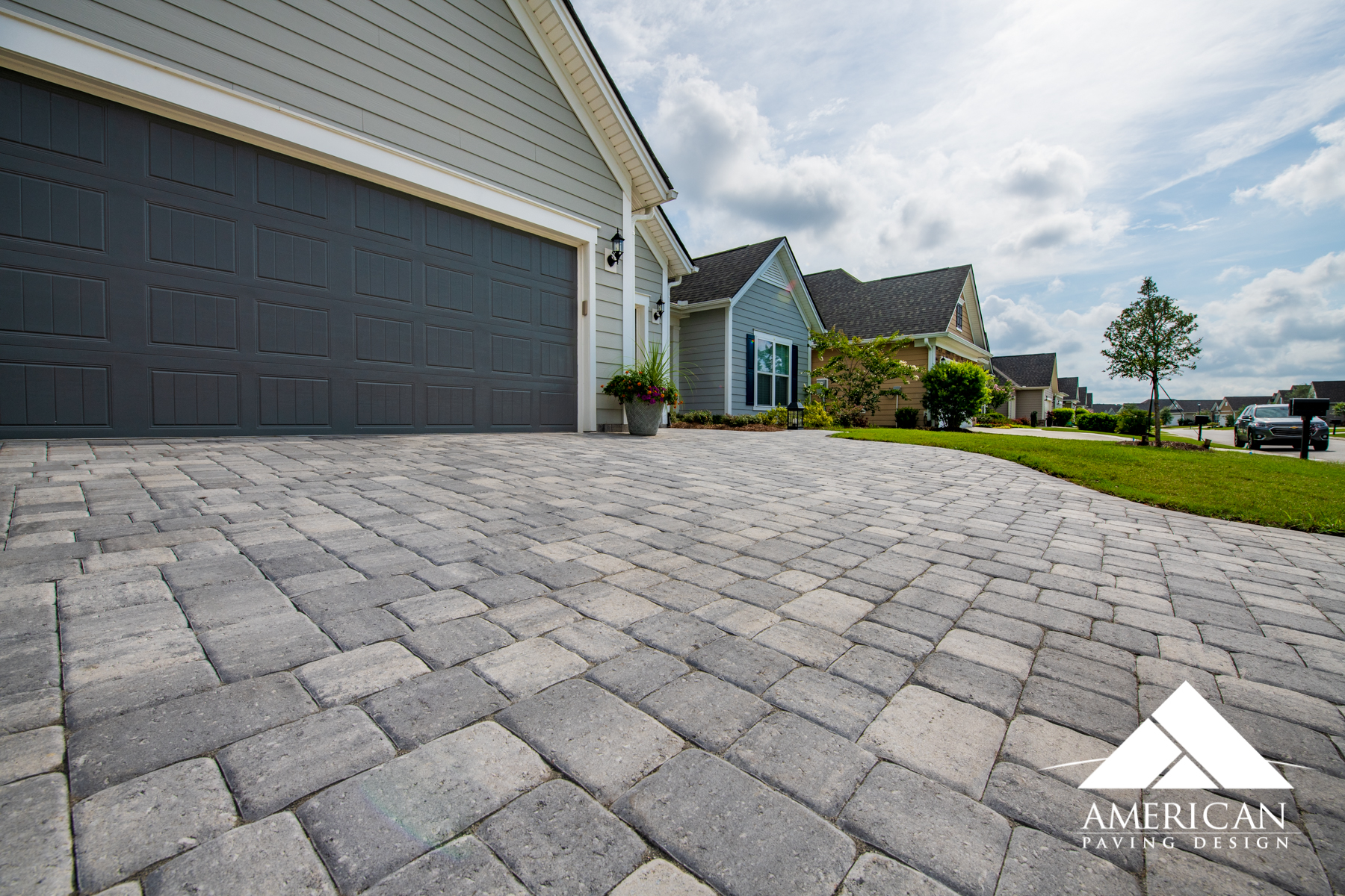 No more tripping hazards! Pavers offer a smooth and durable surface- perfect for your driveway!