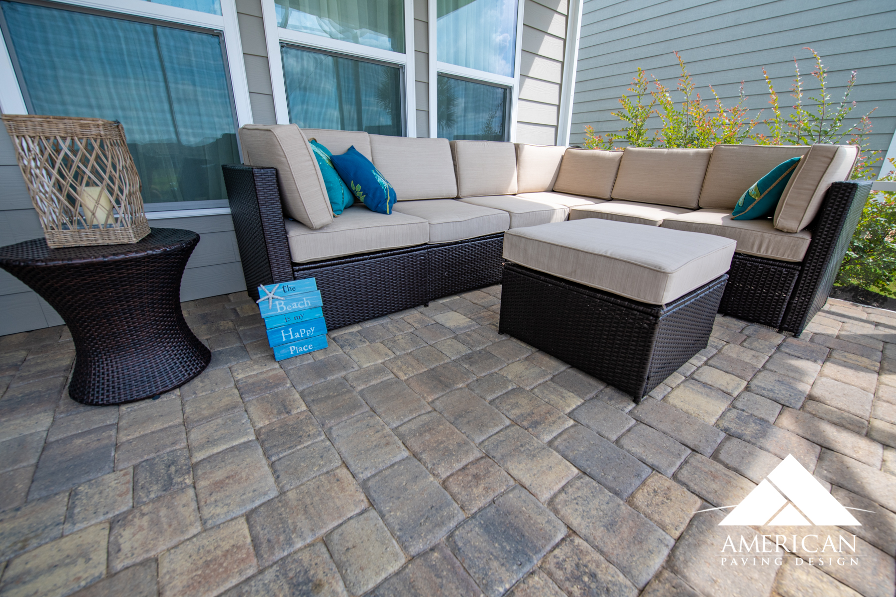 Tan polysand was installed in between the joints of this lanai paver patio. Perfect for reading and relaxing, this homeowner will have little repair issues when it comes to her new paver patio!