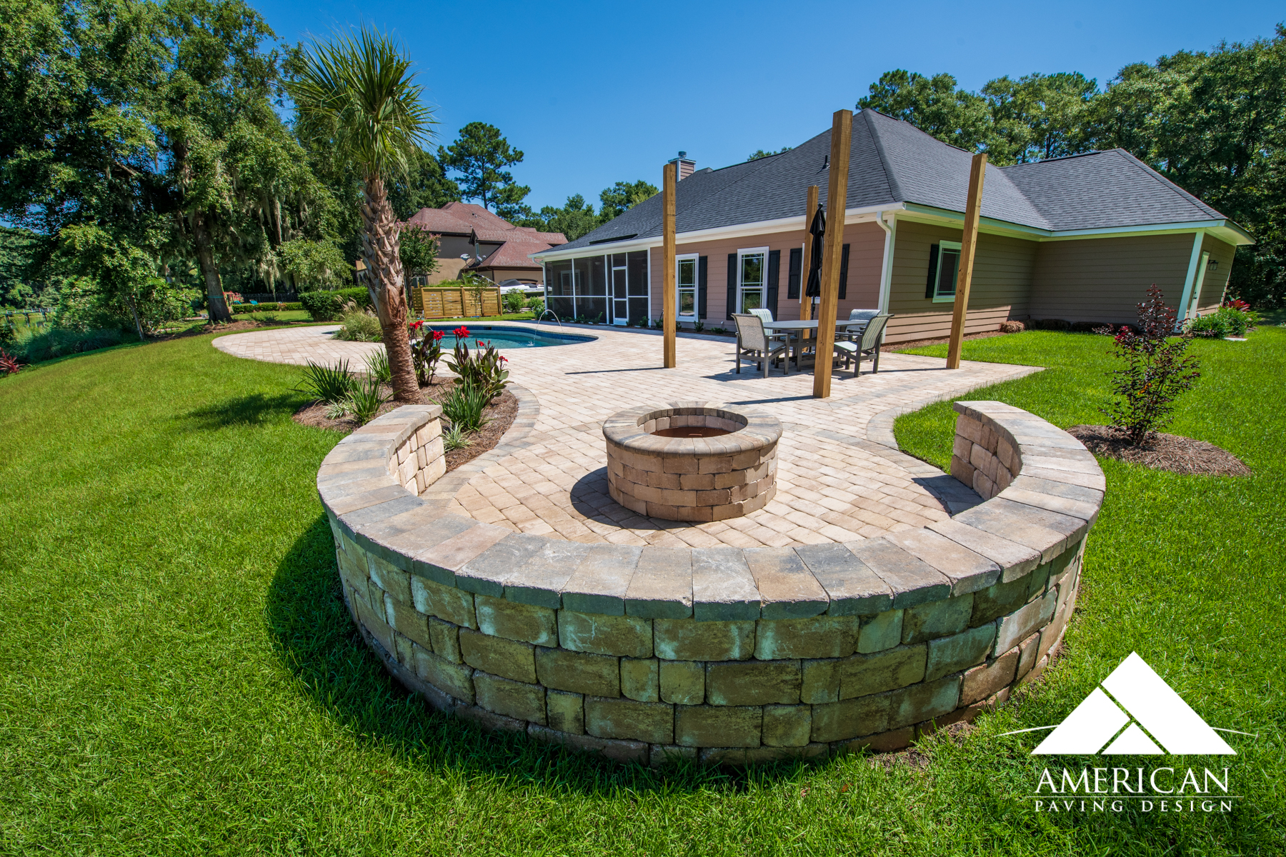 New circular paver patio design! Equipped with a wood burning fire pit and block built seating walls!