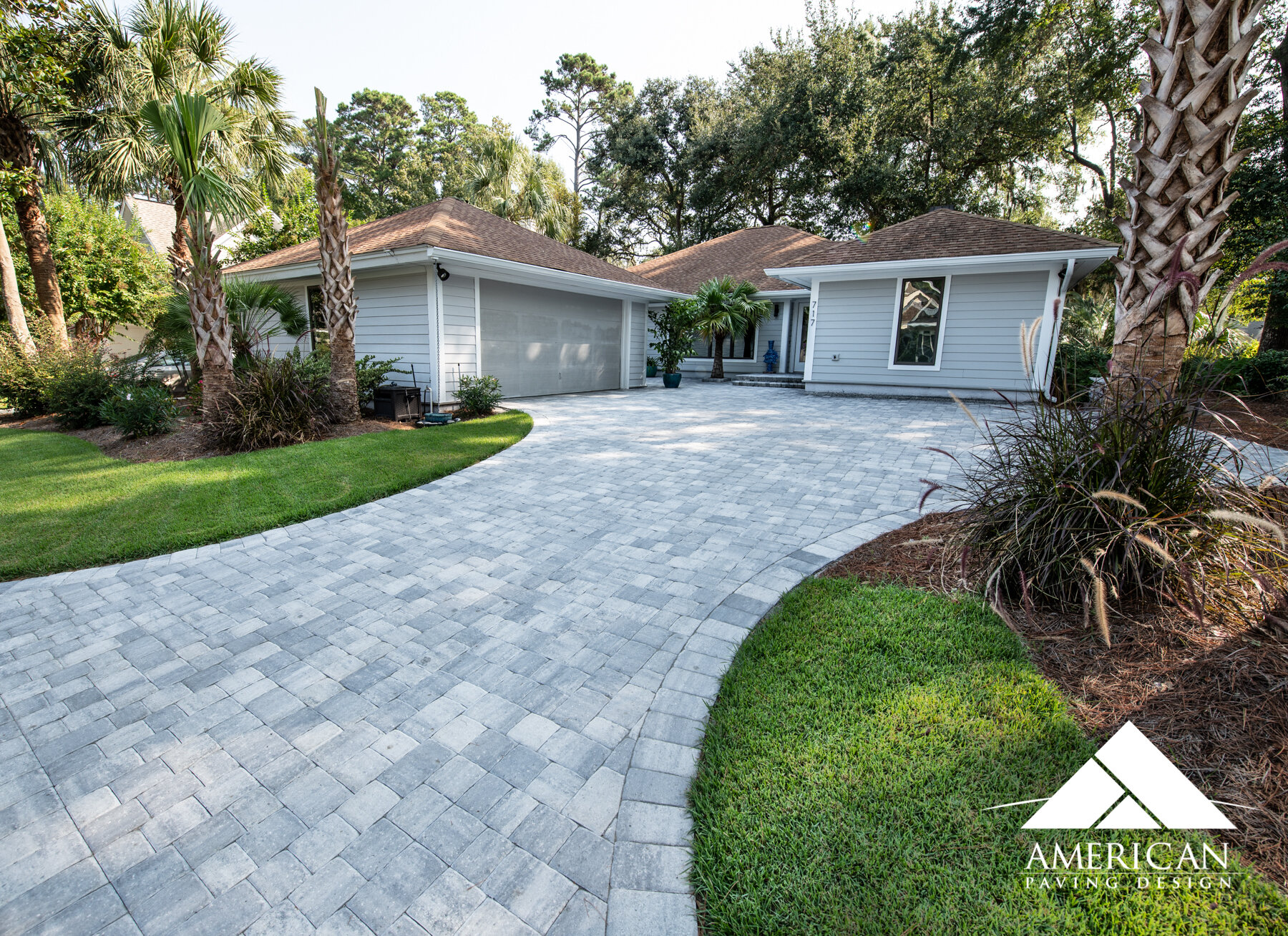 "Newly installed, this  paver driveway  compliments the exterior of this home so well! This  Tremron, Grey paver  named "" Glacier "" accents not only the siding but the trim and roof! With hundreds of colors on the market, customizing your driveway is easy!"