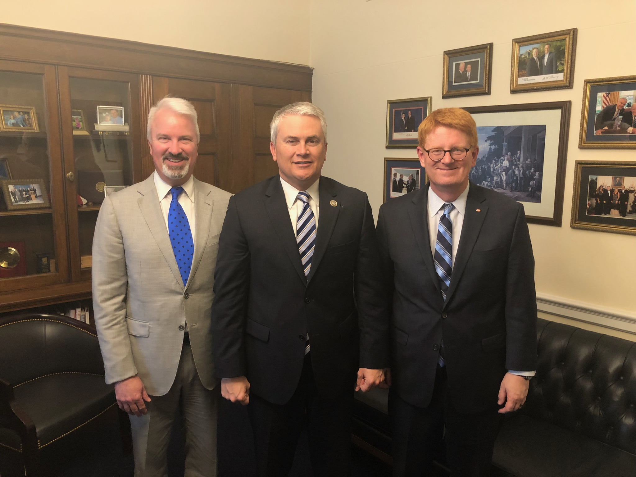 Laurel Grocery Company's Winston Griffin (left) and Ross (right) meet with Congressman Comer (middle).