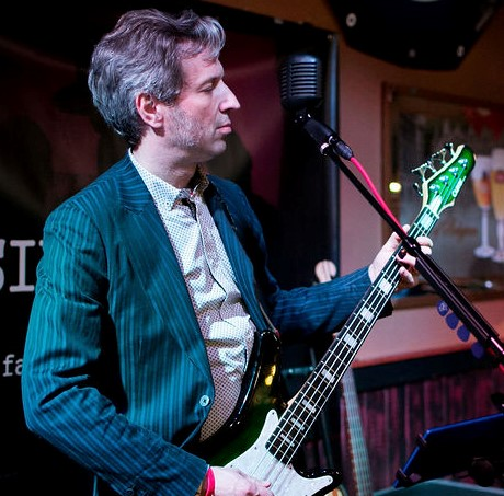 Jonathan Couser (Jonny C.)Bass, vocals, keys - Jonny took up bass just eight years ago, driven by a combined urge to follow the funky rhythms of James Brown's bassists and the prog melodies of Yes' Chris Squire and Rush's Geddy Lee. Diving into the changing music world, he discovered the passion and innovation of new bands like Cold War Kids and the Arctic Monkeys, which he brings to Six Cowards. Before forming this group, Jonny played extensively around the region with classic rock trio the Fuzzboxx, as well as with less active bands like Switchblade Beat, Longhand, and Fallen Houses. By day he teaches history at Plymouth State and once appeared on Jeopardy!, where he took a severe intellectual beating.