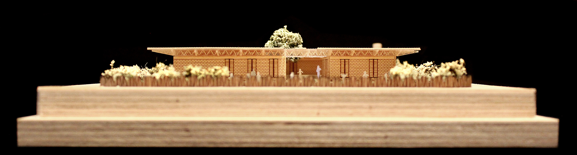 Elevation photograph of a 1 to 200 scale physical wood model of a Modular School Concept for in the Katanga region of the Democratic Republic of Congo by 3bd Architects.jpg