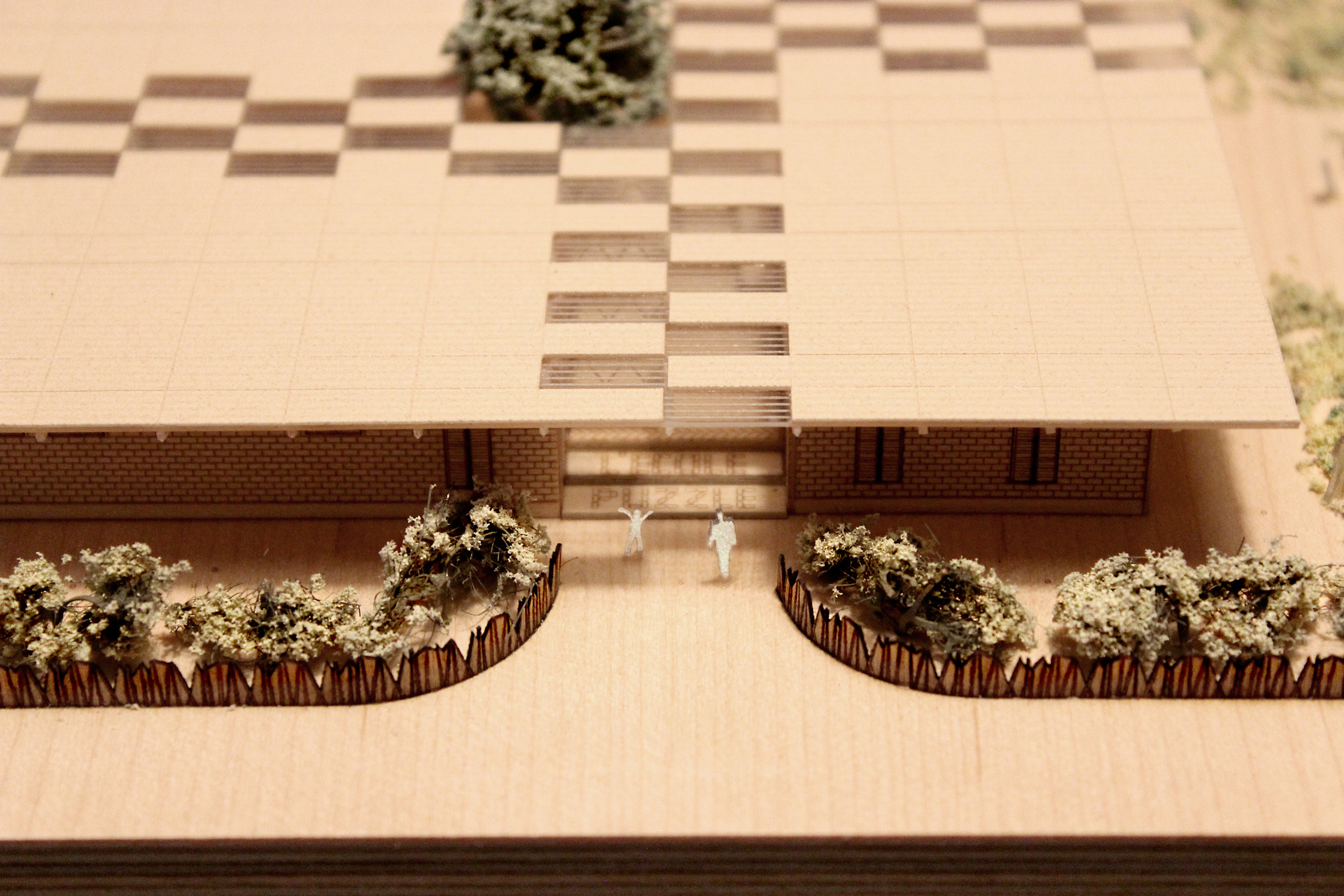 Entrance photograph of a 1 to 200 scale physical wood model of a Modular School Concept for in the Katanga region of the Democratic Republic of Congo by 3bd Architects.jpg