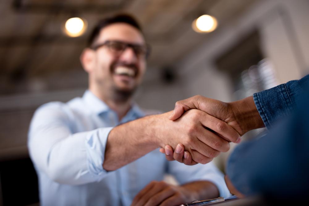 two-men-shaking-hands-happy