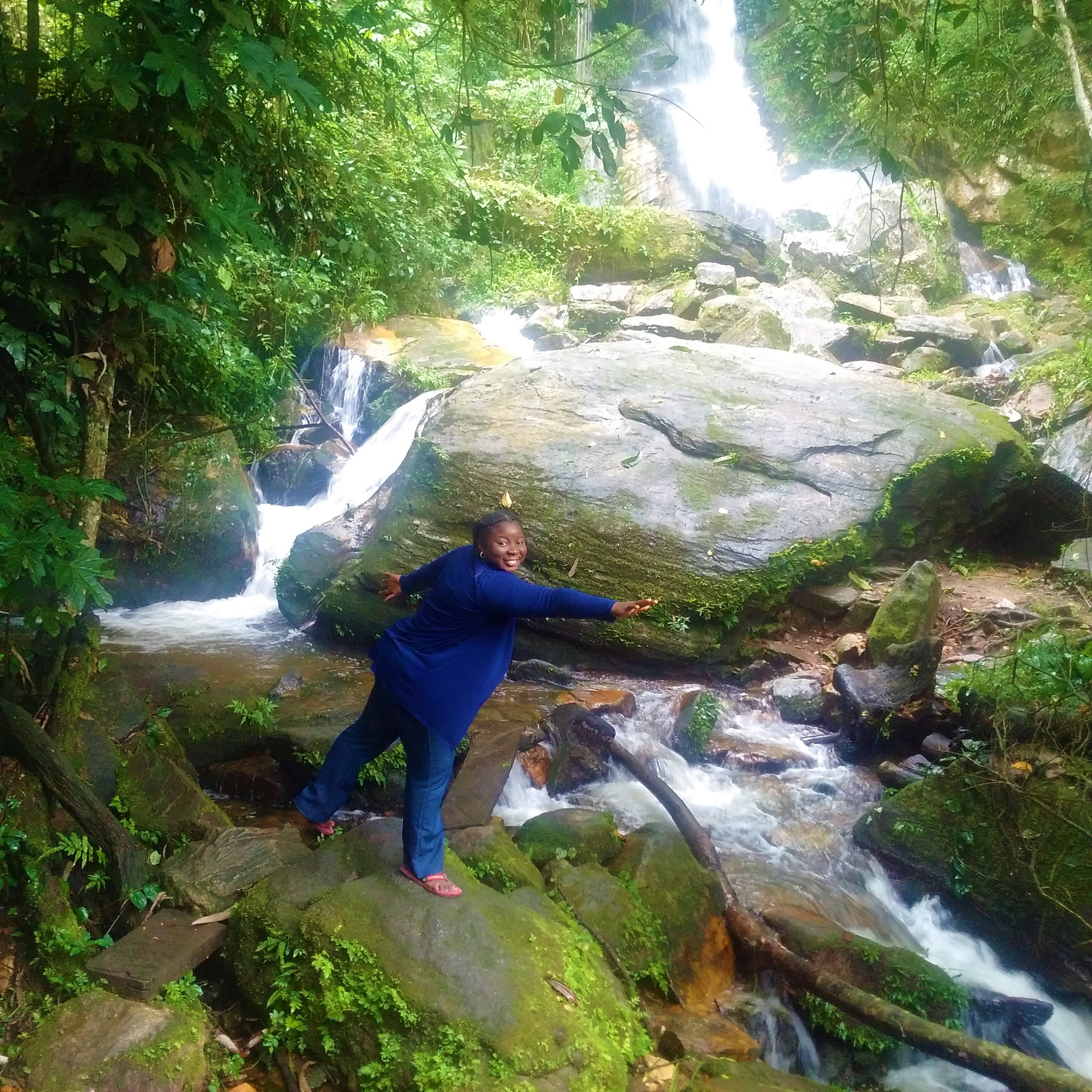 I present Arinta Waterfalls with me trying to practise Yoga.