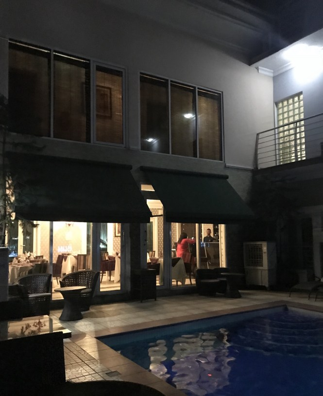 Night view of the hotel from the pool area.