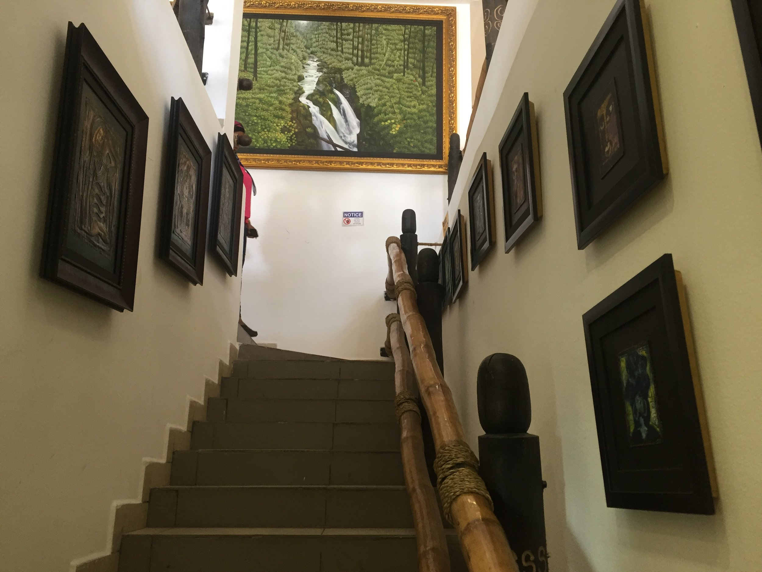 The stairway upsides, filled with art works from Bruce Onobrakpeya