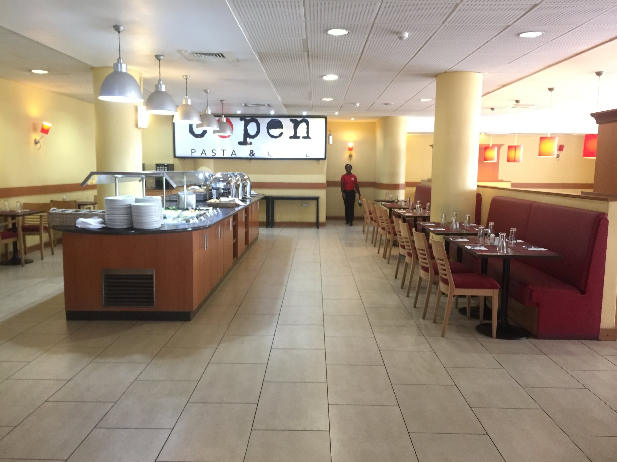 IBIS Airport hotel | Hotels in LagosThe dining area. Breakfast is buffet and complimentary for ONE. An additional person will cost 4,500 or so. Lunch and dinner are buffet for N7,500 or so. Ridiculously expensive!.
