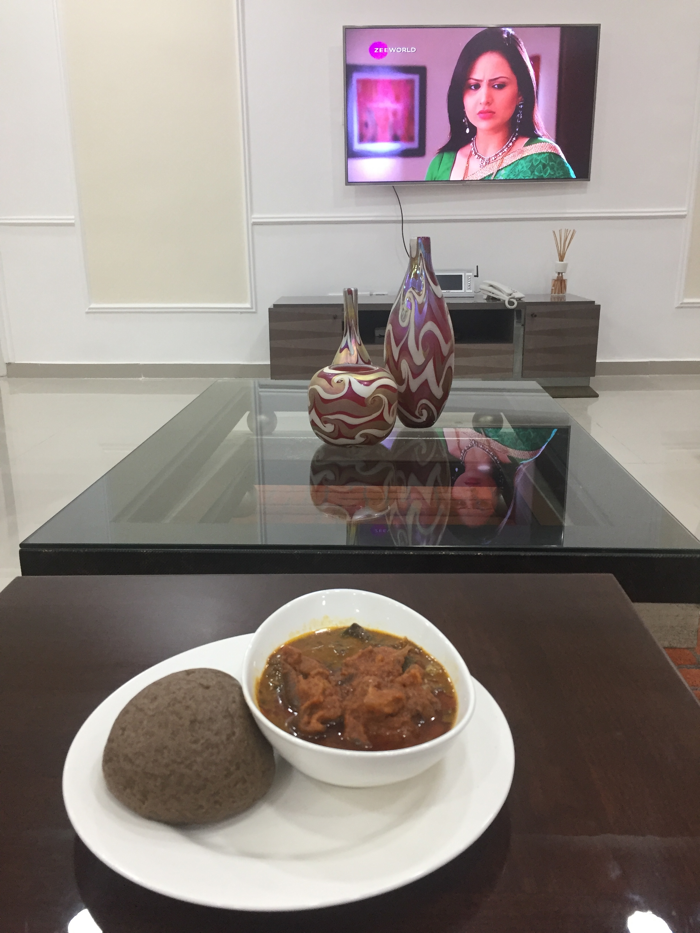 Jubilee Chalets | Amala and Ogbono with goat meat while watching my favourite Channel on Zee world.