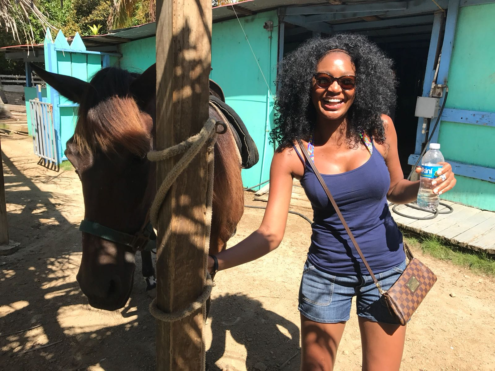 At a stable on Isla palomino with my horse, Chocolate